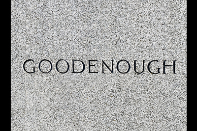 "Image of the word ""Goodenough"" from a gravestone."