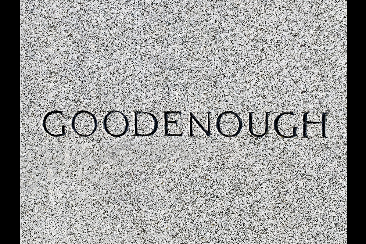 """Image of the word """"Goodenough"""" from a gravestone."""