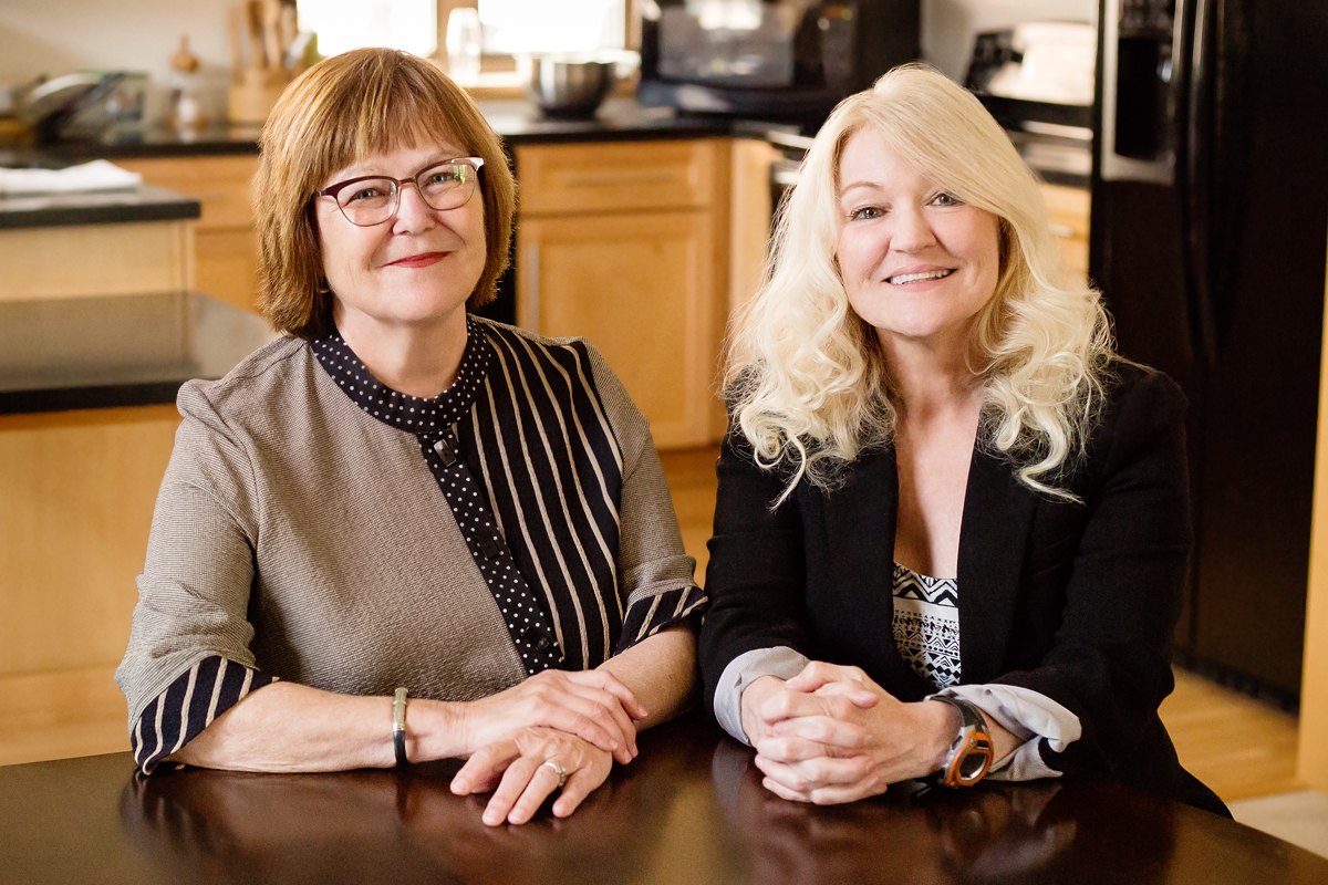 Barbara Fiese and Kelly Freeman Bost sitting at a table in the Family Resiliency Center on the U. of I. campus.