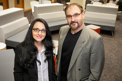Psychology professors Sanda Dolcos, left, and Florin Dolcos stand in an empty seating area in the Beckman Institute.