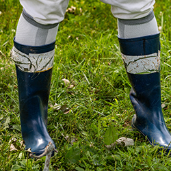 A closeup of Tuten's neoprene boots with double-sided carpet tape on them.