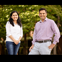 Portrait of researchers Dinumol Devasia and chemistry professor Prashant Jain