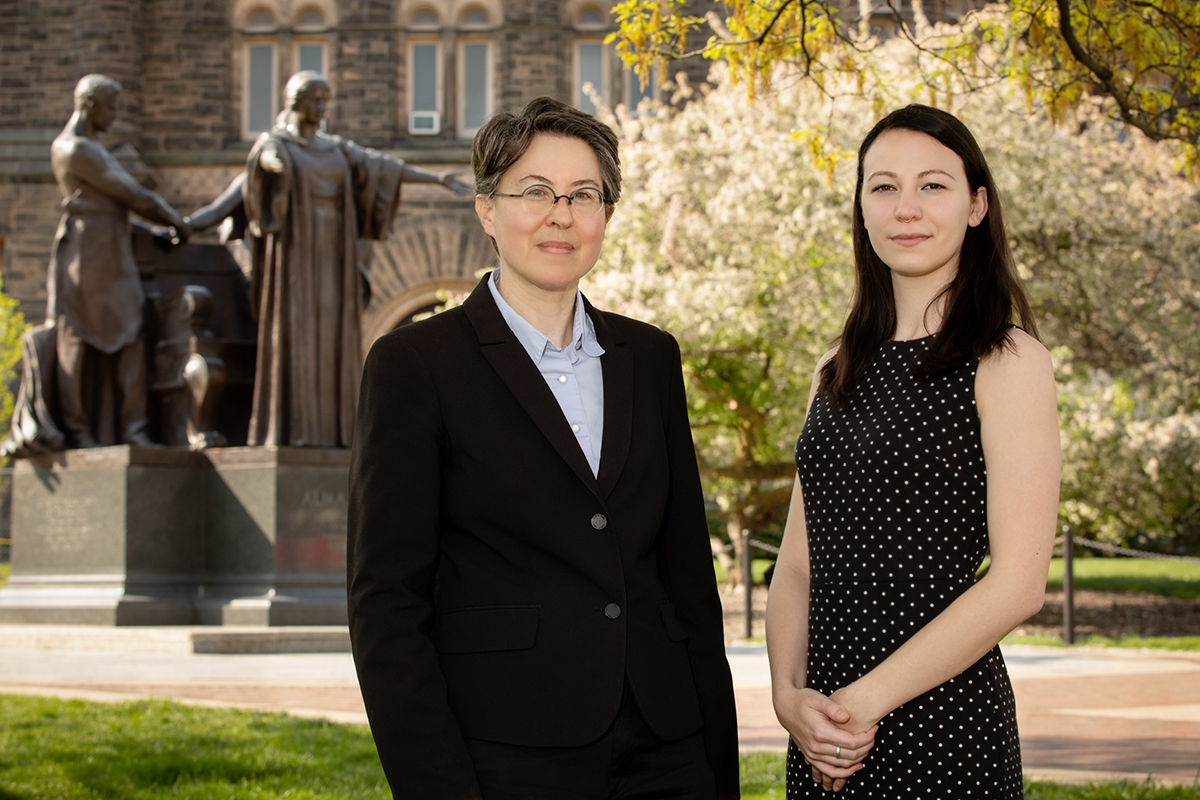 Educational psychology professor Jennifer Cromley and graduate student Andrea Kunze standing outdoors