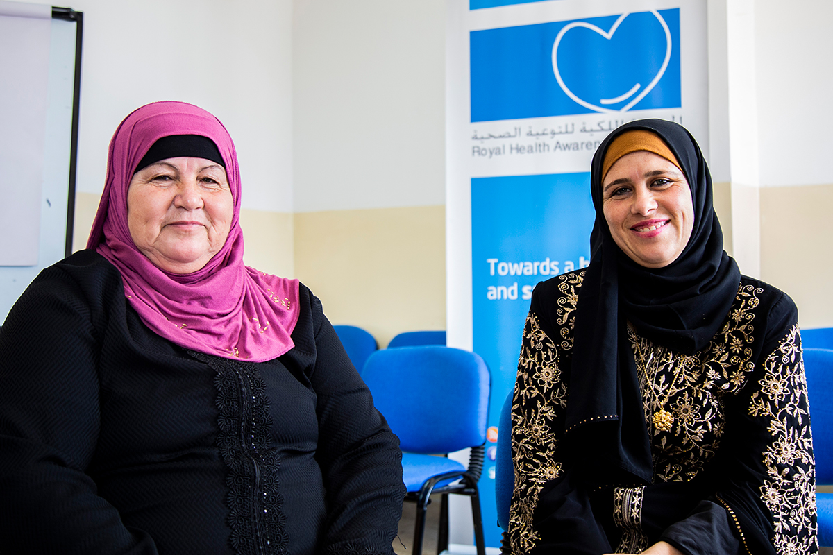 Two women who participated in the program stand in the clinic that hosted the program.