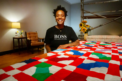 Blair Ebony Smith with her quilt