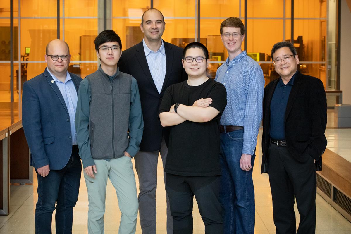 Group portrait of researchers Wawrzyniec Dobrucki, Zhongmin Zhu, Viktor Gruev, Zuodong Liang, Steven Blair and Shuming Nie.