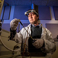 Photo of researcher in laboratory.