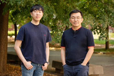 Byungsoo Kim, left, and professor Hyunjoon Kong stand outdoors, socially distanced.