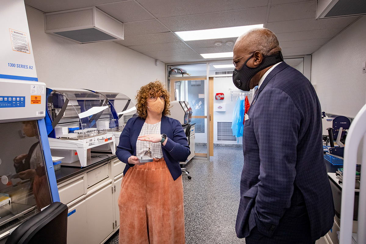 Professor Abigail Wooldridge, left, the project lead for mobileSHIELD, a mobile COVID-19 testing laboratory created by a team from the Grainger College of Engineering, gives Chancellor Robert Jones a tour of the facility. The project will bring COVID-19 testing capability to communities across Illinois and the nation.