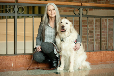 Beckman Institute researcher Joey Ramp poses with her dog, Sampson.