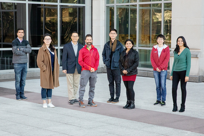 """Group"" photo outside the Carl R. Woese Institute for Genomic Biology on the U. of I. campus."