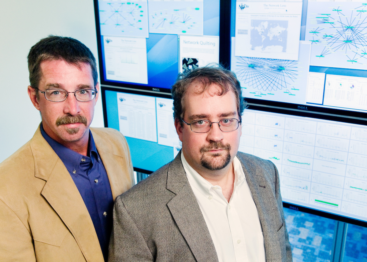 Randy Butler (left) and Von Welch, the co-directors of the Cybersecurity Directorate at the U. of I.'s National Center for Supercomputing Applications, work with law-enforcement agencies in investigating crimes that occur in cyberspace.