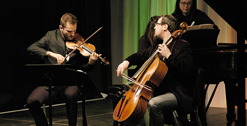 Stefan Milenkovich, left, on violin and Dmitry Kouzov, right, on cello, both faculty members in the University of Illinois School of Music, perform at last year's DoCha chamber music festival. They were accompanied by guest artist Jasmine Arakawa on piano.