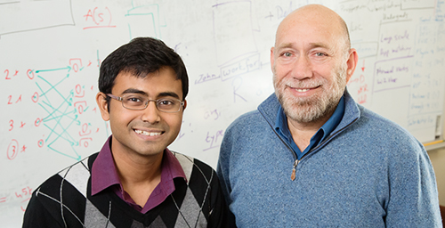 Illinois graduate student Subhro Roy, left, and professor Dan Roth developed software to help computers understand math concepts expressed in text. This will improve data accessibility, search and education.