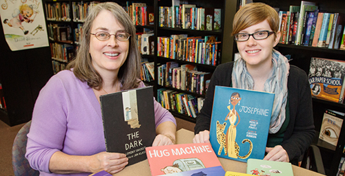 Deborah Stevenson, left, editor of The Bulletin of the Center for Children's Books and director of the Center, and Kate Quealy-Gainer, assistant editor of the Bulletin, with some of the books featured in the 2014 Guide Book to Gift Books. The guide offers suggestions of books to give to children.