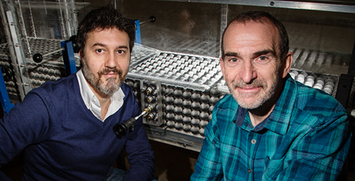 River researchers used a specially constructed model to study how water flows over gravel river beds. Postdoctoral researcher Gianluca Blois (left) and professor Jim Best also developed a technique to measure the water flow between the pore spaces in the river bed.