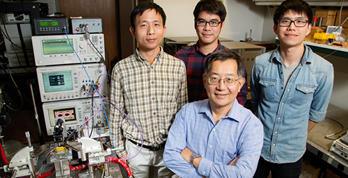 University of Illinois engineers  -  from left, postdoctoral researcher  Fei Tan, graduate students Mong-Kai Wu  and Michael Liu, led by Milton Feng, front - developed a laser that can transmit data at a blazing fast 40 gigabits per second, without errors - the fastest in the U.S.