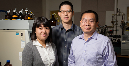 Researchers Lei Zhang, left, and Xinying Wang, center, with Junhua Jiang, a senior research engineer at the Illinois Sustainable Technology Center, are developing high-performance supercapacitors using wood biochar.