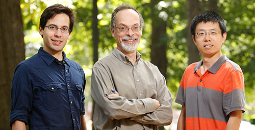 From left, graduate student Derek Caetano-Anolls, crop sciences and Institute for Genomic Biology professor Gustavo Caetano-Anolls and senior bioinformatician Minglei Wang report that the emergence of the genetic code corresponds to the advent of protein flexibility.