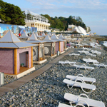 Sochi benefits from a mild climate. Its rock beaches give vacationers a place to take in the sun. In earlier days, sunbathing was considered a medical procedure and was supervised by medical personnel.