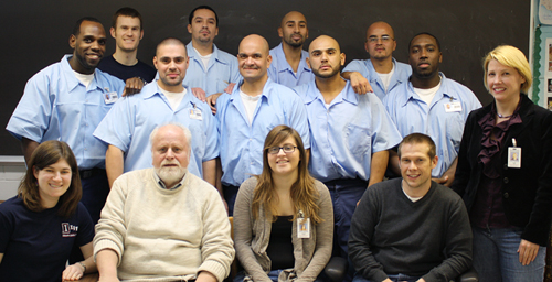 Volunteers from the U. of I. pose at Danville Correctional Center with the Education Justice Project students they trained to teach ESL to other prisoners. The program, called Language Partners, was proposed by EJP student Jose Ramn Cabrales, second from the left in the back row.