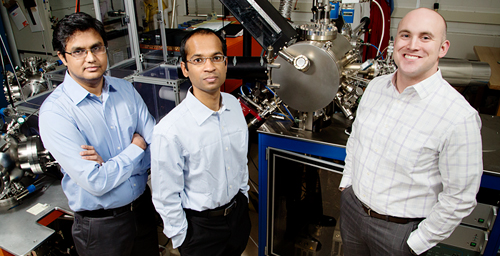 University of Illinois engineers devised a method of making thin films of ferroelectric material with twice the strain of traditional methods, giving the films exceptional electric properties. Professor Lane Martin, right, led the work with graduate student Karthik Jambunathan, center, and postdoctoral researcher Vengadesh Mangalam.