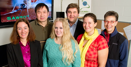 University of Illinois entomology professor Barry Pittendrigh (back right) and his colleagues create animated educational videos as part of the Scientific Animations Without Borders project. Pictured: back row left: entomology research scientist Weilin Sun; front row from left: SAWBO co-founder Julia Bello-Bravo, who also is assistant director of Illinois Strategic International Partnerships; graduate students Laura Steele and Alice Vossbrinck; and research specialist Susan Balfe.