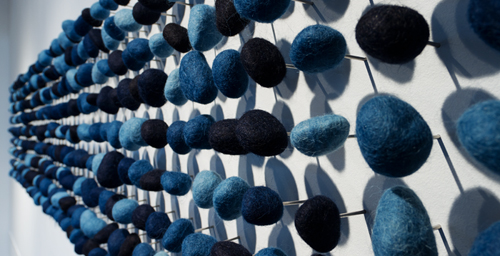 """This series of indigo-dyed felted stones was created by textile artist Rowland Ricketts, inspired by his years as an apprentice with indigo workers in Japan. It is one of the works featured in """"Fields of Indigo,"""" opening Aug. 31 at Krannert Art Museum."""