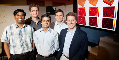 University of Illinois engineers developed a method to computationally correct aberrations in three-dimensional tissue microscopy. From left, postdoctoral researcher Steven Adie, professor P. Scott Carney, graduate students Adeel Ahmad and Benedikt Graf, and professor Stephen Boppart.