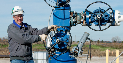 Robert J. Finley, principal investigator on the Illinois Basin - Decatur Project, turns the main valve to start injection of CO2 into the Mount Simon Sandstone.