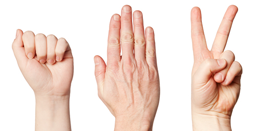 Rock, paper or scissors? Learning while playing a strategic game against others involves a different pattern of brain activity than learning from the consequences of one's own actions, researchers found.