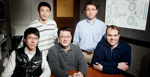 Illinois researchers developed spiral polypeptides that can deliver DNA segments to cells with high efficiency and relatively low toxicity, a step toward clinical gene therapy. The team, from left, postdoctoral researchers Lichen Yin and Dong Li; Fei Wang, a professor of cell and developmental biology; Jianjun Cheng, a professor of materials science and engineering; and Nathan Gabrielson, a postdoctoral researcher.