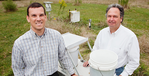Researchers Christopher Lehmann, left, and David Gay completed a 25-year study of acidic pollutants in rainwater collected across the U.S. and found that both frequency and concentration of acid rainfall has decreased.