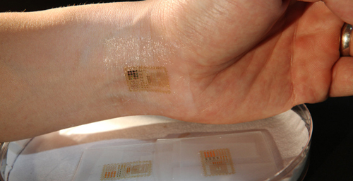 An ultrathin, electronic patch with the mechanics of skin, applied to the wrist for EMG and other measurements.