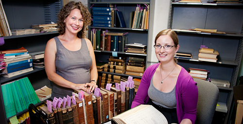 Illinois librarians Jennifer Hain Teper, left, and Emily Shaw see mass-digitization projects as an opportunity to restore crumbling books.