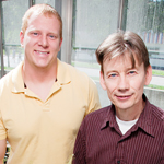 University of Illinois animal biology professor and department head Ken Paige, right, and doctoral student Daniel Scholes discovered that some plants multiply their chromosomes without undergoing cell division after they have been grazed, a process that boosts their productivity above that of plants not damaged by grazing.