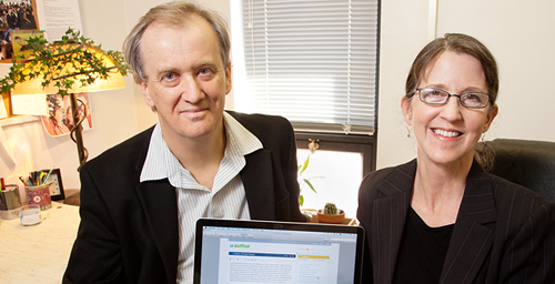 Education professor Bill Cope is leading an interdisciplinary team developing software that may transform the way writing is assessed. Team member Colleen Vojak is the project coordinator.