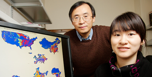 Civil and environmental engineering professor Ximing Cai, left, and graduate student Xiao Zhang performed a global analysis of marginal land that could produce biofuel crops.