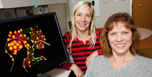 Cell and developmental biology professor Lisa Stubbs, right, and postdoctoral researcher Katja Nowick and their colleagues found distinct differences in gene activity between humans and chimps. These differences are associated with about 90 transcription factors, they found.
