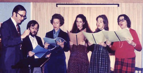 Carolers Nicholas Temperley, Dennis Michael Davis (known as Mike Davis), Mary Sleator Temperley, Lucy Temperley, Jean Geil, Janet Peltz practice in 1989.