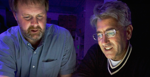 Lawrence B. Schook, right, a professor of biomedical sciences, with animal sciences professor Jonathan Beever. Schook led the international pig genome sequencing project, which has produced a draft of the pig genome.