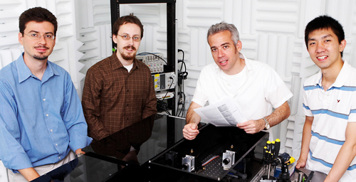From left, University of Illinois physics professor Yann Chemla, graduate student Patrick Mears, physics professor Ido Golding and graduate student Lance Min developed a technique that allows researchers to watch bacteria swim normally for up to an hour.