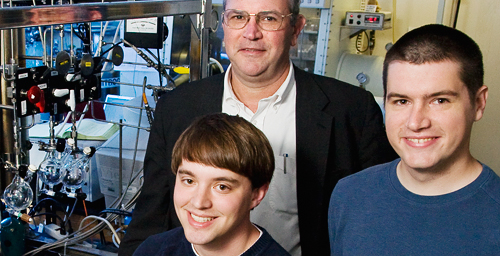 Chemistry professor Thomas B. Rauchfuss, center, and graduate students Bryan Barton, left, and Matthew Whaley have co-written a paper that describes their work in creating a synthetic catalyst that acts like nature's 'hydrogen processor.'