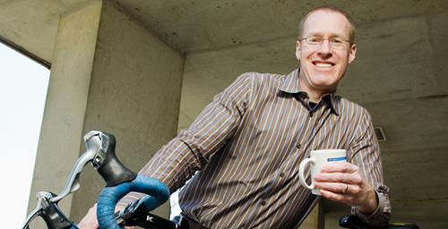 Former competitive cyclist Robert Motl, now a professor of kinesiology and community health, is studying the effects of caffeine on pain during exercise.