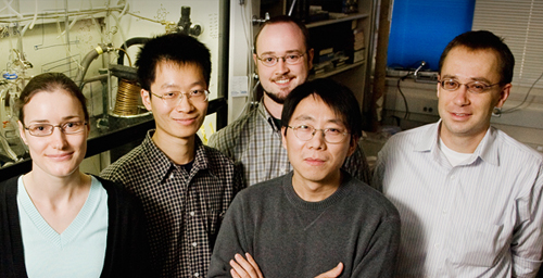 Chemists at Illinois who have created a simple and inexpensive molecular technique that replaces an expensive atomic force microscope for studying what happens to small molecules when they are stretched or compressed: from left, Daria Khvostichenko, postdoctoral researcher; Zhen Huang and Timothy Kucharski, graduate students; Qing-Zheng Yang, research associate; and Roman Boulatov, professor of chemistry.
