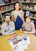 Tanya Lee, standing, program director for Asian Educational Media Service; events coordinator Jason Finkelman; and assistant program coordinator Susan Norris, are responsible for the successful expansion of the service to 118 libraries in East Central Illinois.