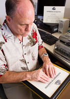 Bryan McMurray is the only staff member in the Disability Resources and Educational Services division who has been trained to use the office's Perkins Braille writer.