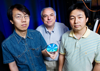 Researchers led by chemistry professor Dana Dlott, center, have improved the sensitivity of a measurement technique that helps in detecting deadly fumes, chemical spills or hidden explosives. Other members of the team are graduate student Ying Fang, left, and postdoctoral research associate Nak-Hyun Seong.