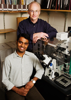 From left, graduate student Vijay Gupta and Steven Blanke, an Illinois professor of microbiology, have discovered how an H. pylori toxin gets into cells.