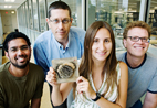 Working on the wasp genetics study were, from left, graduate student Kranthi Varala; Gene Robinson, professor of entomology; postdoctoral researcher Amy Toth (holding a wasp nest); and Matthew Hudson, professor of crop sciences.